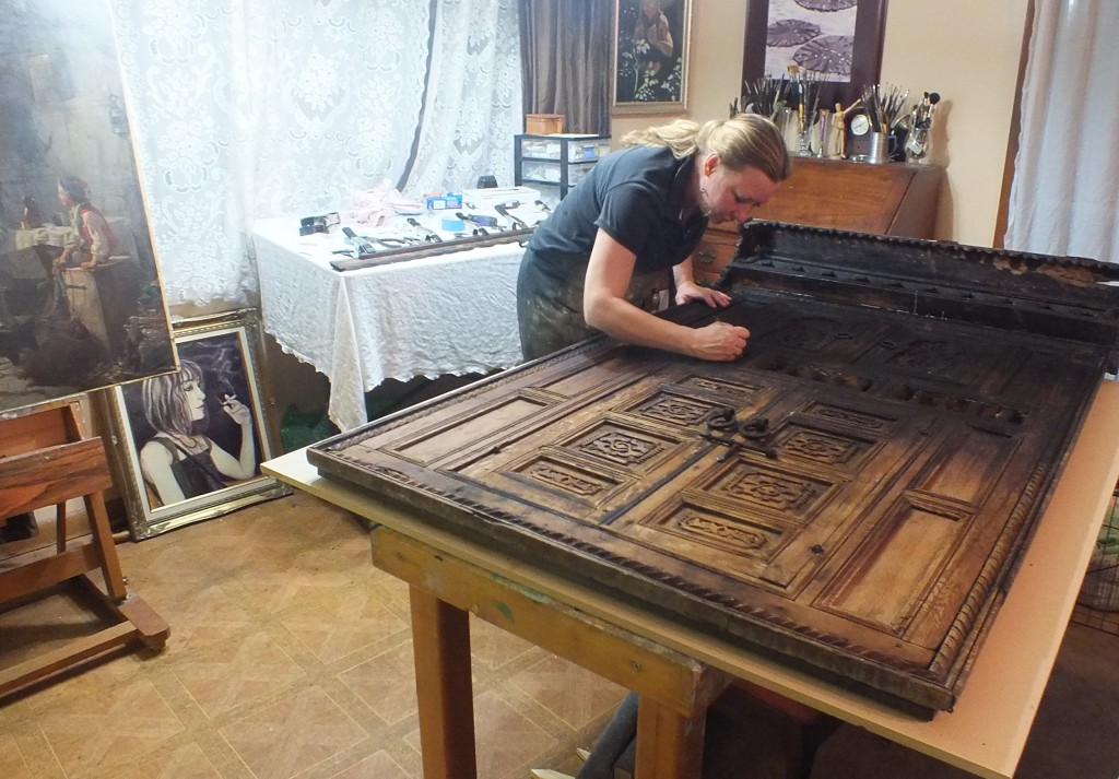 Kate beginning restoration on a 200 year old Moroccan door.