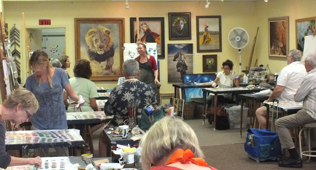 Kate Wood teaching color mixing in one of her art classes.
