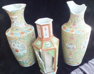 Three tragically damaged vases.