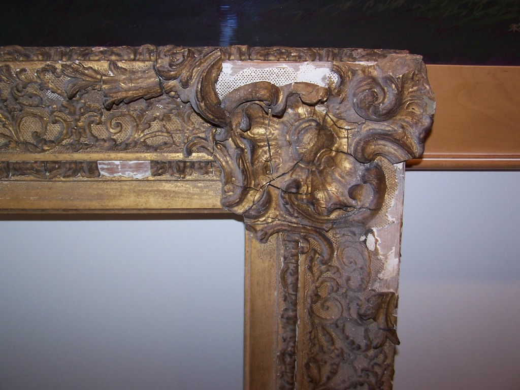 Missing ornament and degraded gilding on an antique frame.