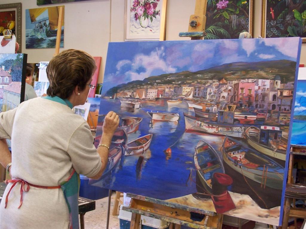 Student Elizabeth Acosta paints during class.