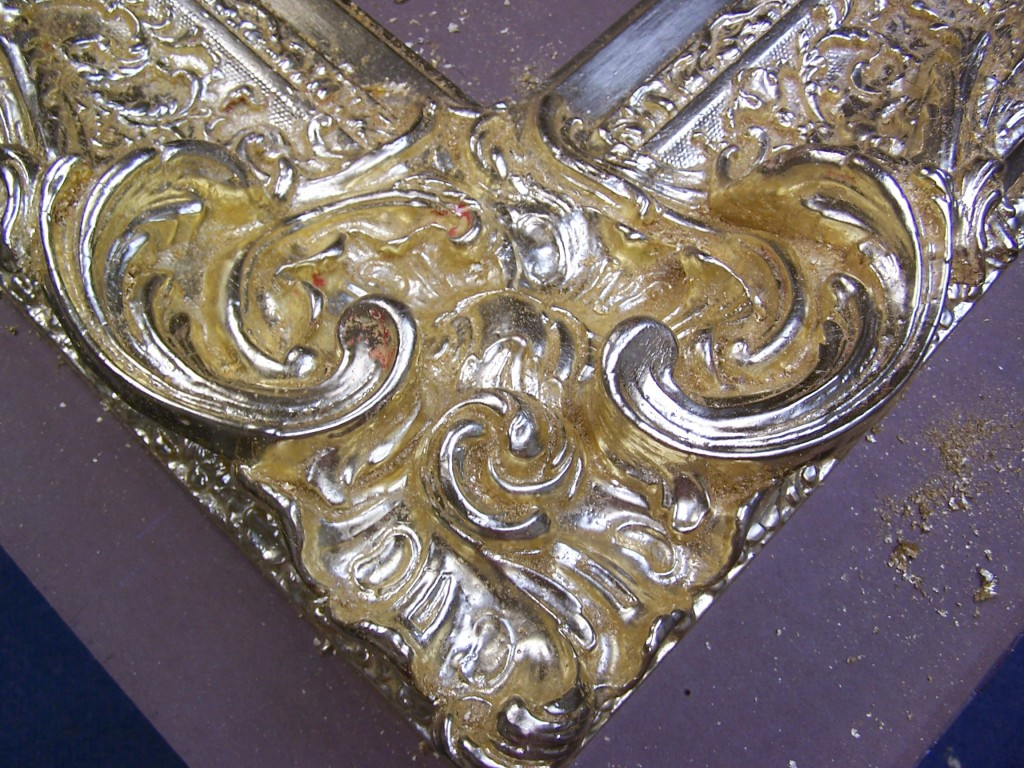 Finished repaired and gilded frame.